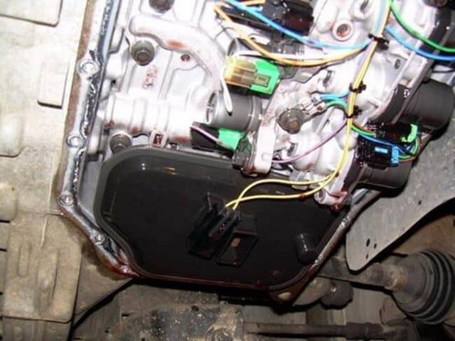 Сколько литров масла нужно заливать в АКПП Форд Фокус 1