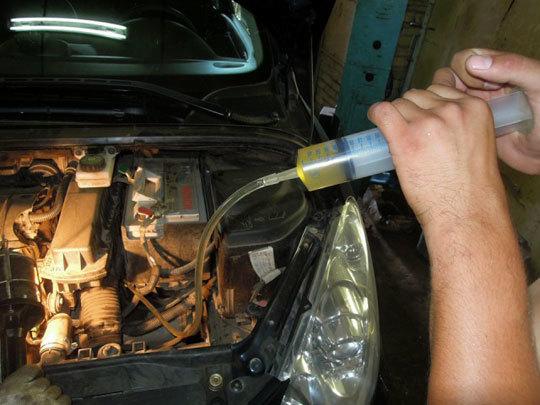 Сколько литров масла нужно заливать в АКПП Пежо 307